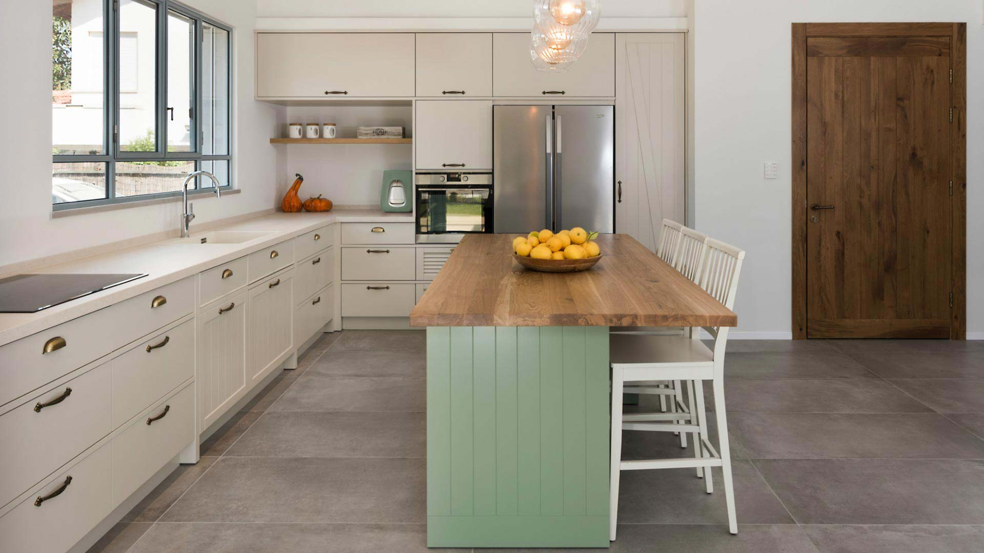 cream-colored-country-kitchen-with-green-island2